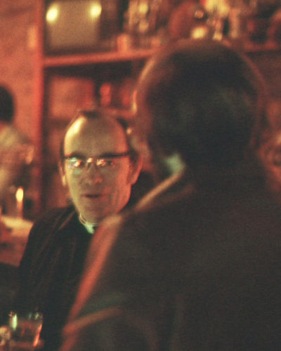 Photo of street minister talking with man in a bar