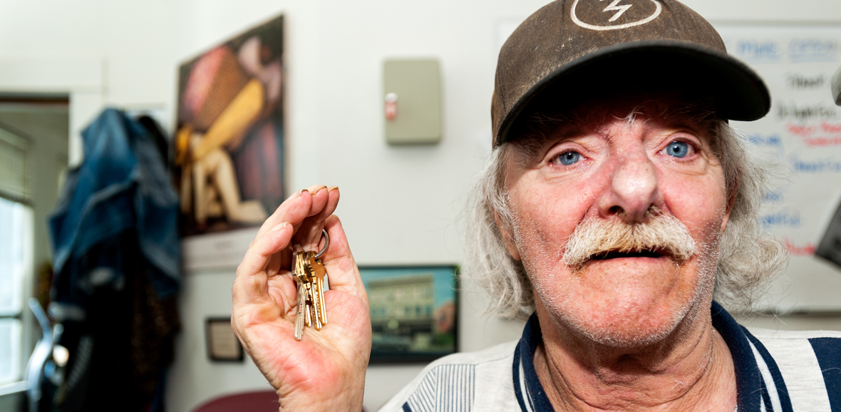 Photo of man smiling and holding keys.