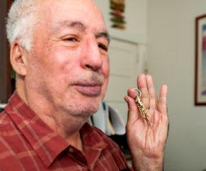 Photo of senior citizen holding a key