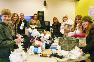 Photo of volunteers counting socks at Sock It event