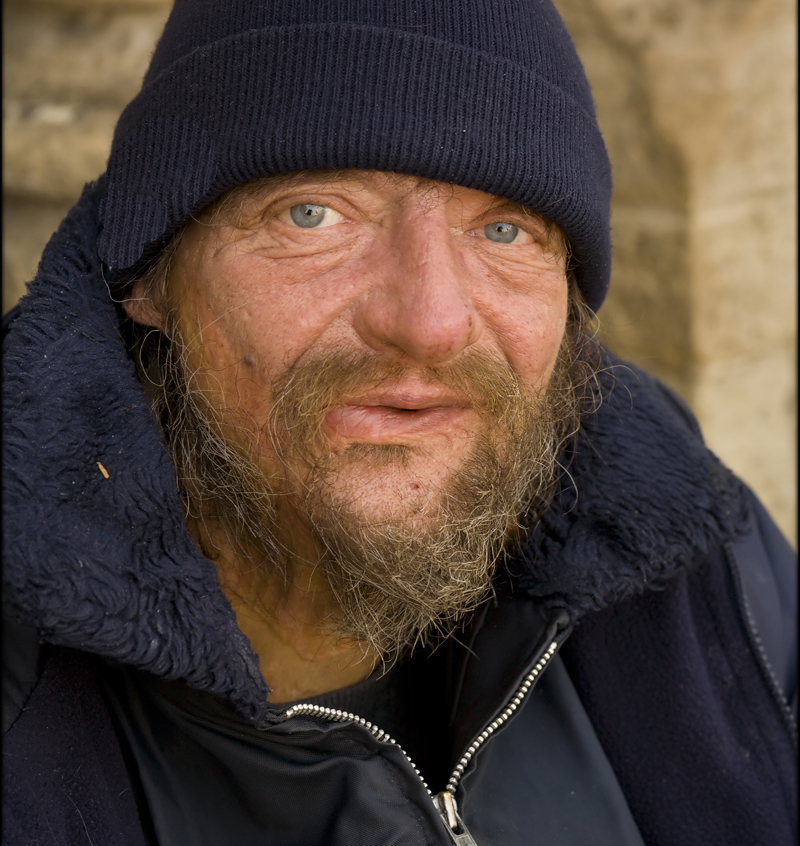 Photo of homeless man in hat